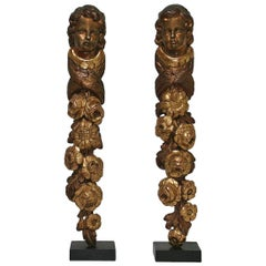 Pair of French 18th Century Baroque Giltwood Ornaments with Angel Heads