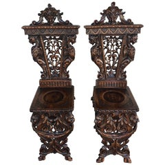 Pair of Flemish Carved Walnut Fireside Chairs