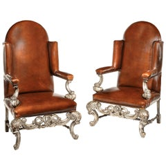 Antique Pair of Silver Gilt Leather Upholstered Wing Chairs