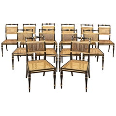 Set of Twelve Regency Dining Chairs in Ebonized and Gilded Decoration