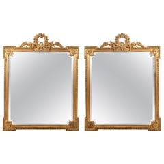Early 20th Century Matching Pair of Giltwood Hanging Beveled Mirrors