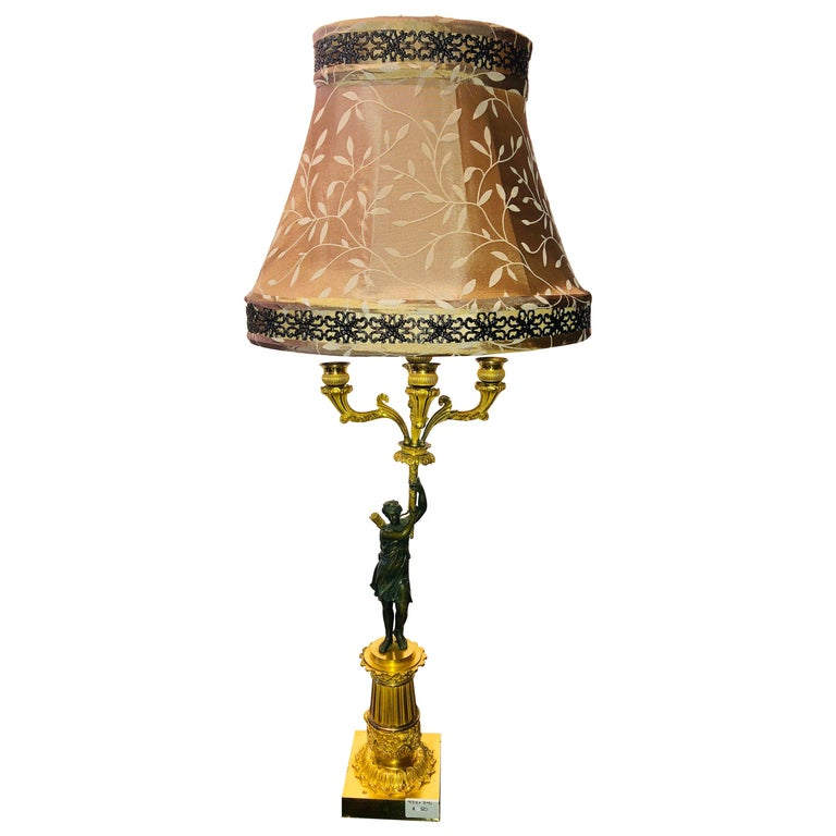 Empire Doré Bronze Candelabra Lamp Having a Patinated Woman Mounted as a Lamp
