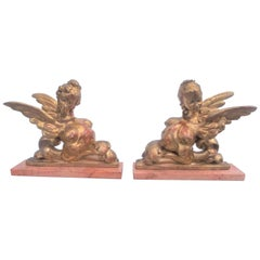 Pair of Carved Giltwood Sphinx Form in Neoclassical Caricature