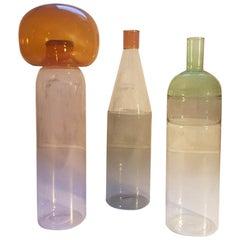 Three Italian Bottles in Blown Glass Colored in Pink Green Grey Orange, Milano