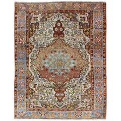 Multi-Colored and Ivory Antique Persian Bakhtiari Rug with Floral Medallion