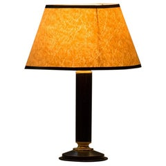 Mid-century modern table lamp in the style of Jacques Adnet