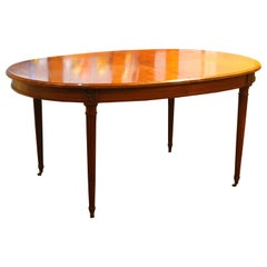 French Louis XVI Style Oval Extending Dining Mahogany Table with Wheel Feet
