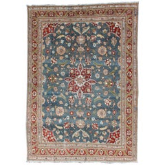 Antique Persian Tabriz Rug with Floral Medallion Design in Red and Blue