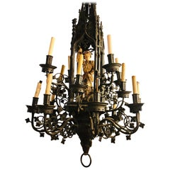 Palace Sized Wrought Iron Chandelier with a Gilt Carved Wooden Figure of a Man