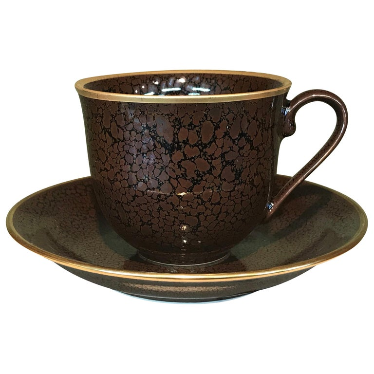 Japanese Gilded Hand-Glazed Brown Porcelain Cup and Saucer by Master Artist