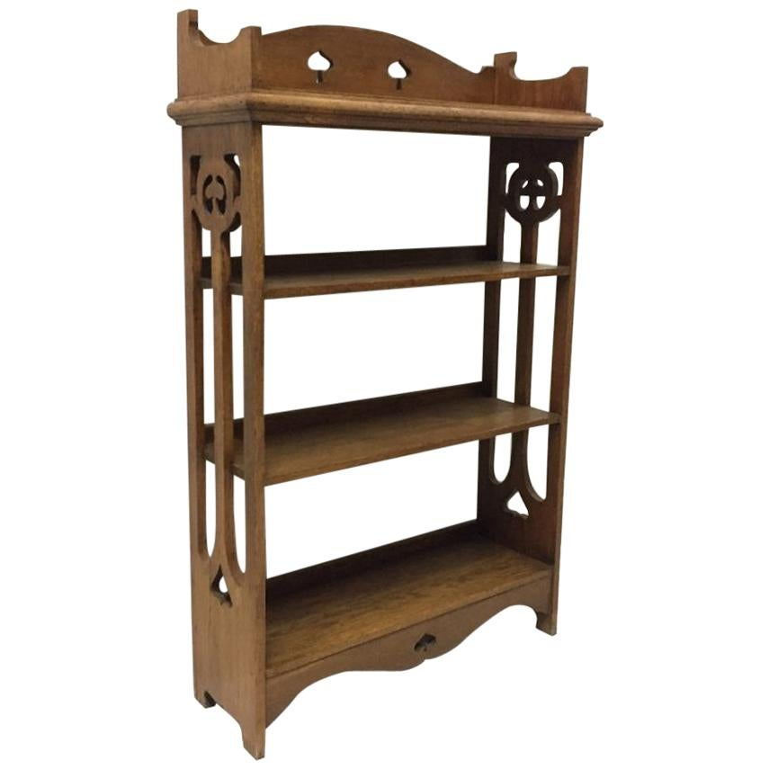 Liberty & Co Attributed, an Arts & Crafts Oak Bookcase with floral cut-outs