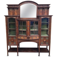 Waring and Gillows, an Exceptional, Bow Fronted Inlaid Display Cabinet