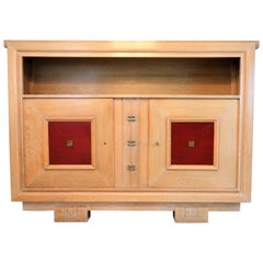 Charles Dudouyt Masterpiece Oak Cabinet, with Doorpanels Covered in Red Leather