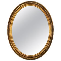 19th Century French Oval Mirror Gilded with Gold Leaf