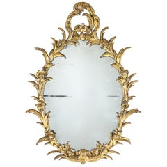 George III Oval Mirror with a Carved Giltwood Floral Frame