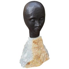 Midcentury Made Bronze Sculpture of a Serene African Male on a Limestone Base