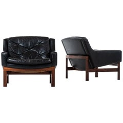 Pair of Easy Chairs in Rosewood and Black Leather Produced in Sweden