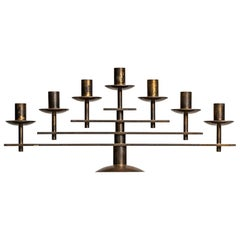 Heavy candlestick in brass produced in Denmark