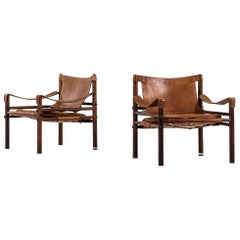 Arne Norell Easy Chairs Model Sirocco in Rosewood and Brown Leather
