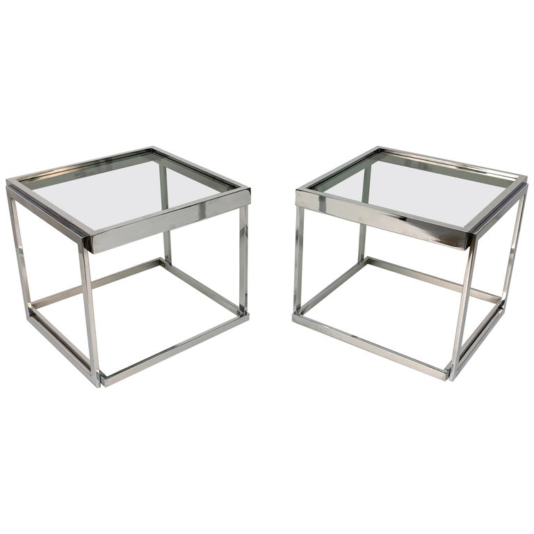 Pair of chromed metal coffee tables with smoked glass. Stackable. Italy 1970s