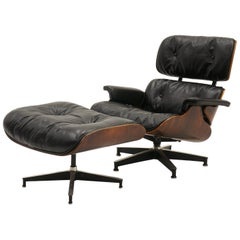 Rare 1st Series Eames Lounge Chair and Ottoman. Rosewood and Black Leather