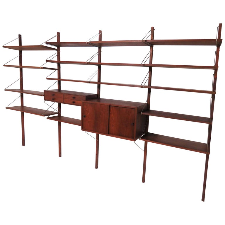 """Four-Bay Midcentury """"Cado"""" Style Wall Mounted Shelving Unit, circa 1960s"""