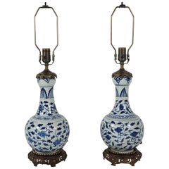 Pair of Bronze Accented Chinese Blue & White Garlic Head Vases Mounted as Lamps