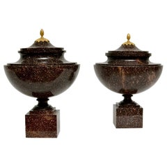 """Pair of Gustavian """"Blyberg"""" Porphyry Urns with Ormolu-Mounted Porphyry Lids"""