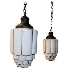 Pair of Tiered Milk Glass Art Deco Skyscraper Pendant Lights, circa 1930