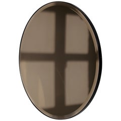 Bevelled Bronze Tinted Orbis™  Round Mirror with a Black Frame - Medium