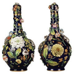 Pair of English Porcelain Floral Covered Vases, circa 1840