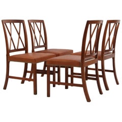 Ole Wanscher Set of Four Dining Chairs in Mahogany and Cognac Aniline Leather