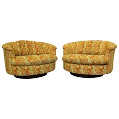 Pair of Mid-Century Modern Groovy Round Selig Swivel Lounge Chairs