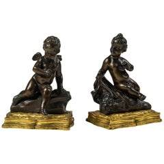 Pair of Louis XV Ormolu and Patinated Bronze Figural Paper Weights