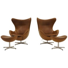 Pair of Arne Jacobsen Egg Chairs with Ottomans for Fritz Hansen, Cognac Leather