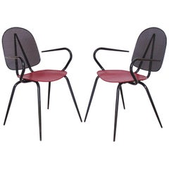 Manner of Mathieu Matégot Black and Red Perforated Metal Armchair, a Pair