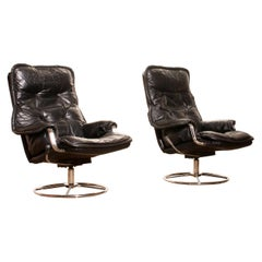 1970s Pair of Black Leather Swivel Chrome Steel Lounge Chairs, Sweden