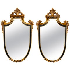 Pair of Hollywood Regency Style Ebony and Gilt Wood Wall or Console Mirrors