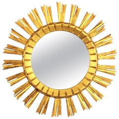 Early 20th Century French Medium Sized Baroque Giltwood Sunburst Mirror
