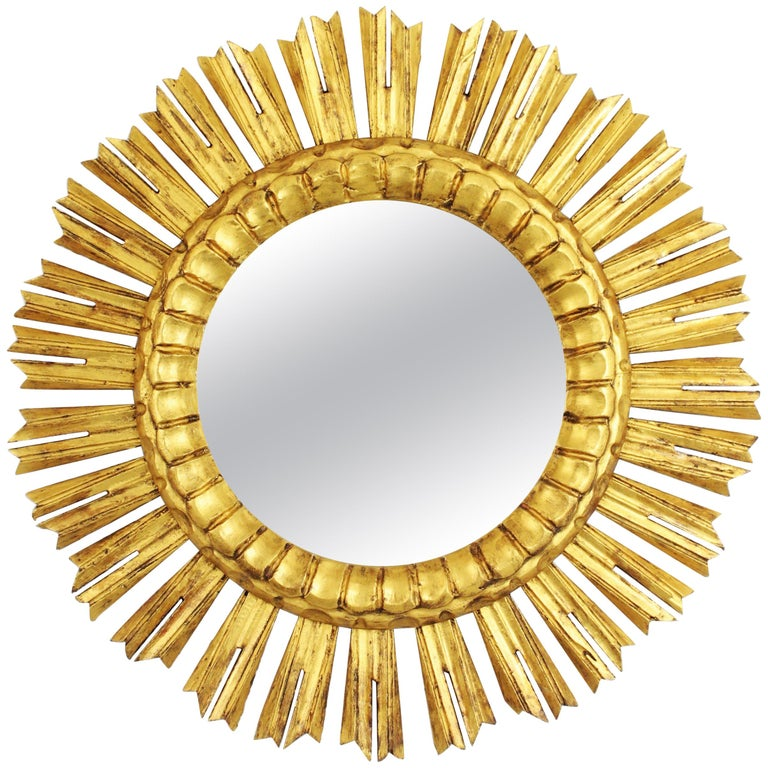 French 1930s Medium Sized Carved Giltwood Sunburst Mirror For Sale