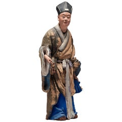 Chinese Sculptured and Painted Clay Figure of a Man Holding a Lingzhi Mushroom