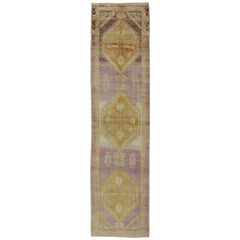 Antique Turkish Oushak Runner with Three Geometric Medallions in Purple Tones