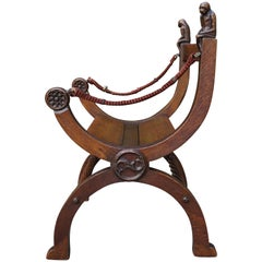 19th Century Aesthetic Movement X-Frame Chair w. Hand Carved Monkey Finials