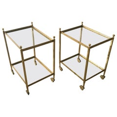 Pair of Maison Jansen Brass and Glass Two-Tier Rolling Occasional Tables or Cart