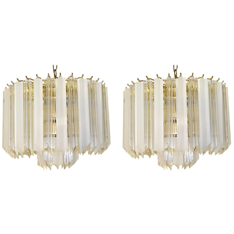 Pair of Hollywood Regency Lucite Triedri Prism Crystal Chandeliers For Sale