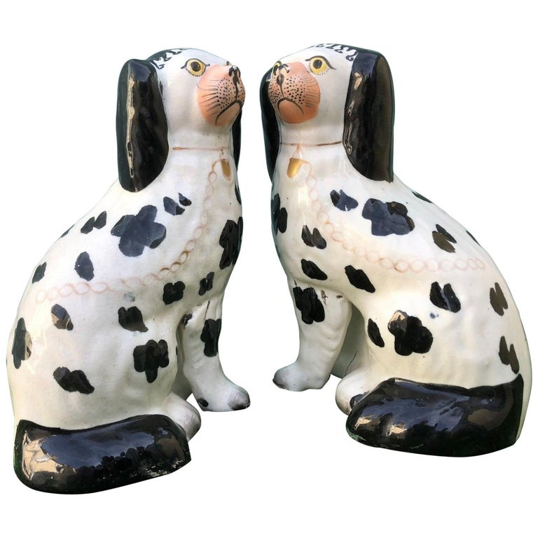 19th Century Staffordshire Seated Disraeli Black and White Spaniel Dogs For Sale
