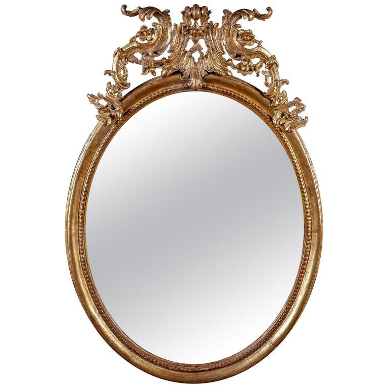 18th Century Italian Oval Shape Giltwood Mirror For Sale