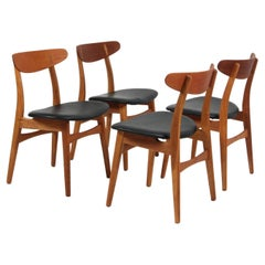Set of Four Hans J. Wegner Dining Chairs Model CH-30 in Teak and Oak