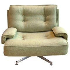 C20th Swivel Kohinoor Armchair by Howard Keith