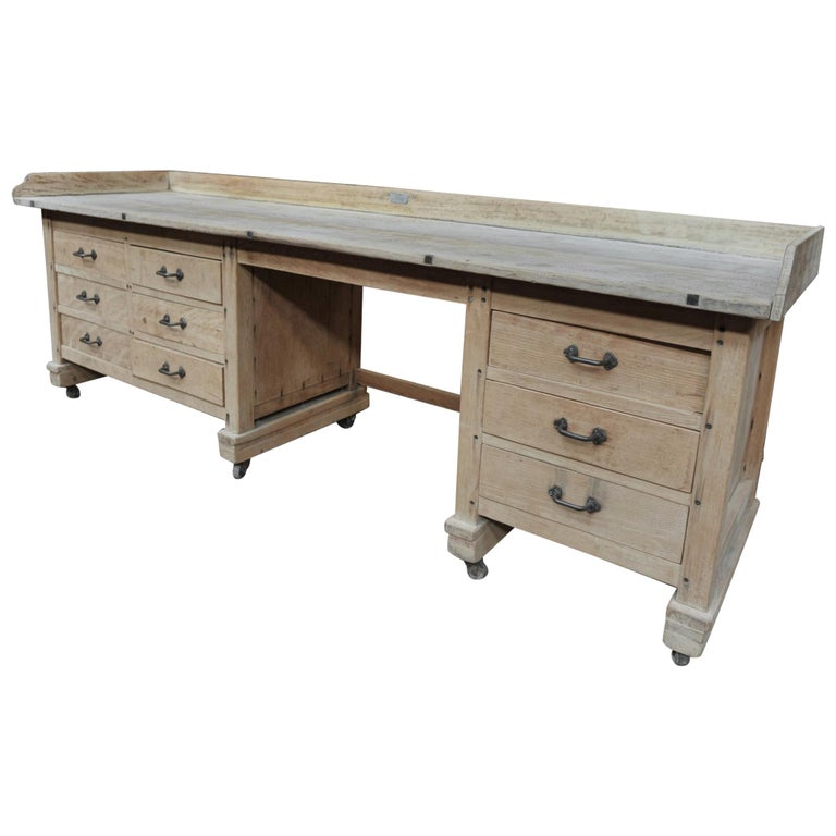 Exceptional Long Baker Work Table with 9 Drawers, circa 1920 For Sale